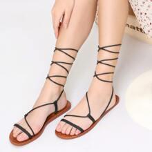 Sandalias gladiador con tiras tobilleras cruzadas de punta abierta