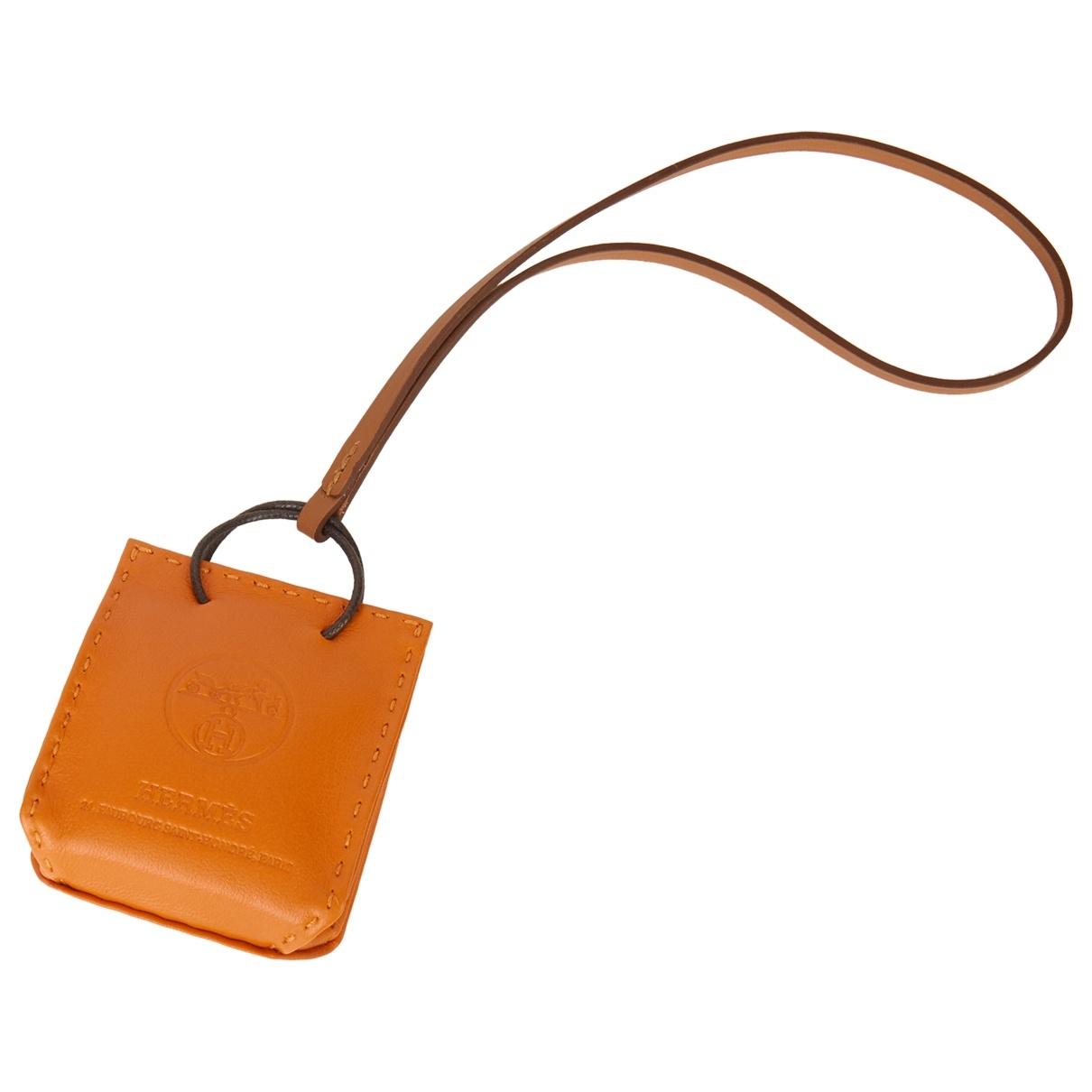 Hermes Shopping bag charm Taschenschmuck in  Orange Leder
