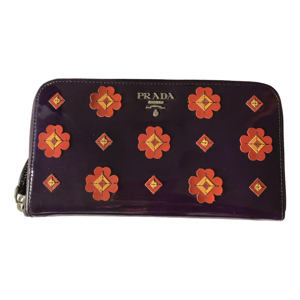 Prada - Portefeuille   pour femme en cuir verni - violet