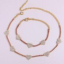 Collar y pulsera con diseño de corazon con diamante de imitacion