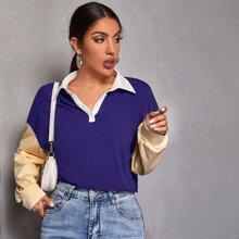 Polo Shirt mit sehr tief angesetzter Schulterpartie und Farbblock