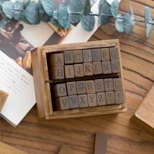 26 piezas 1 caja sello con letra inglesa