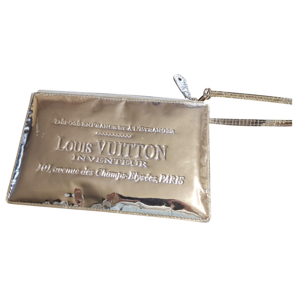 Louis Vuitton - Pochette   pour femme en cuir verni - argente