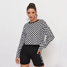 Crop Pullover mit sehr tief angesetzter Schulterpartie und Karo Muster