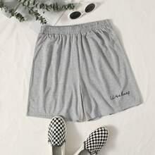 Shorts de cintura elastica con letra