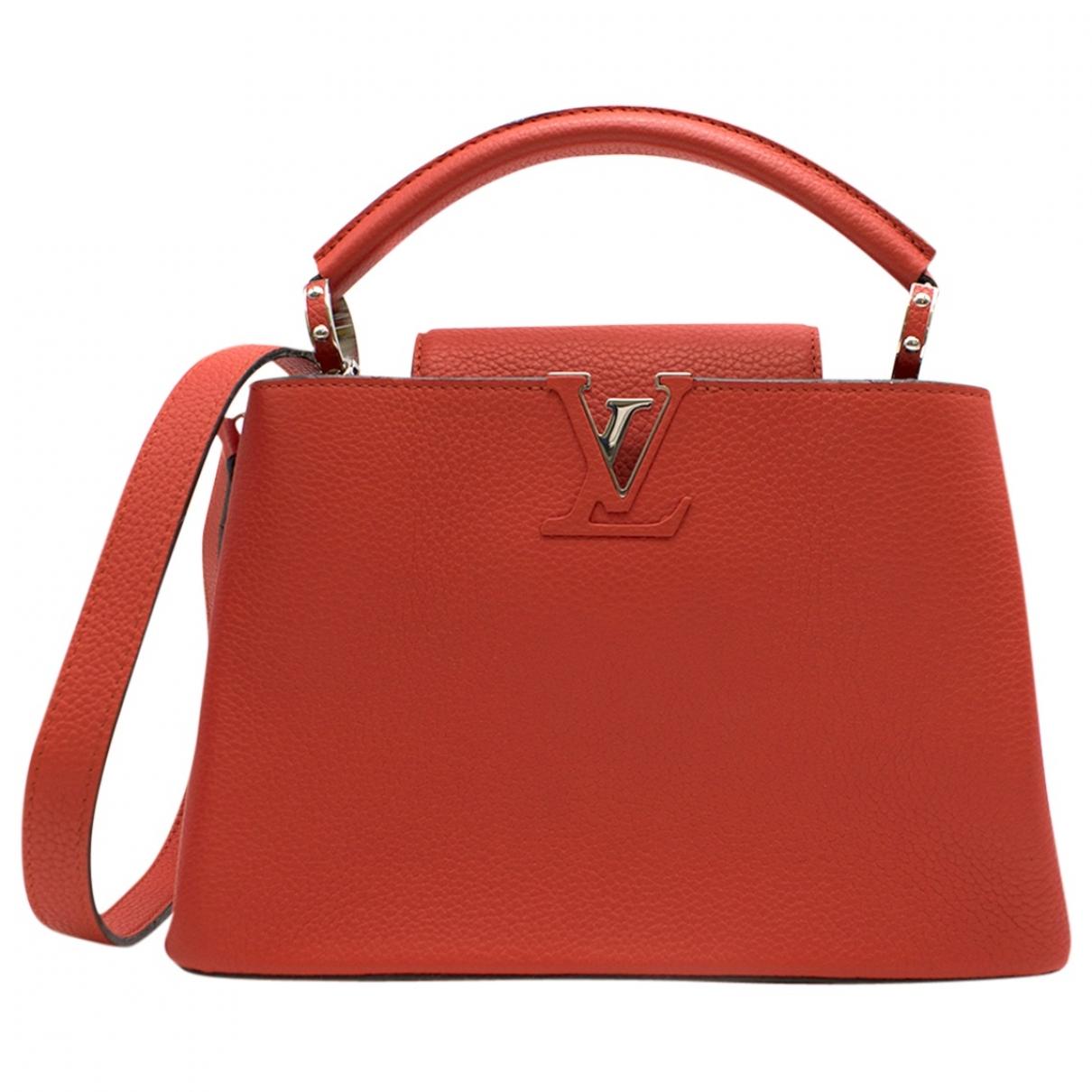Louis Vuitton Capucines Handtasche in  Rot Leder