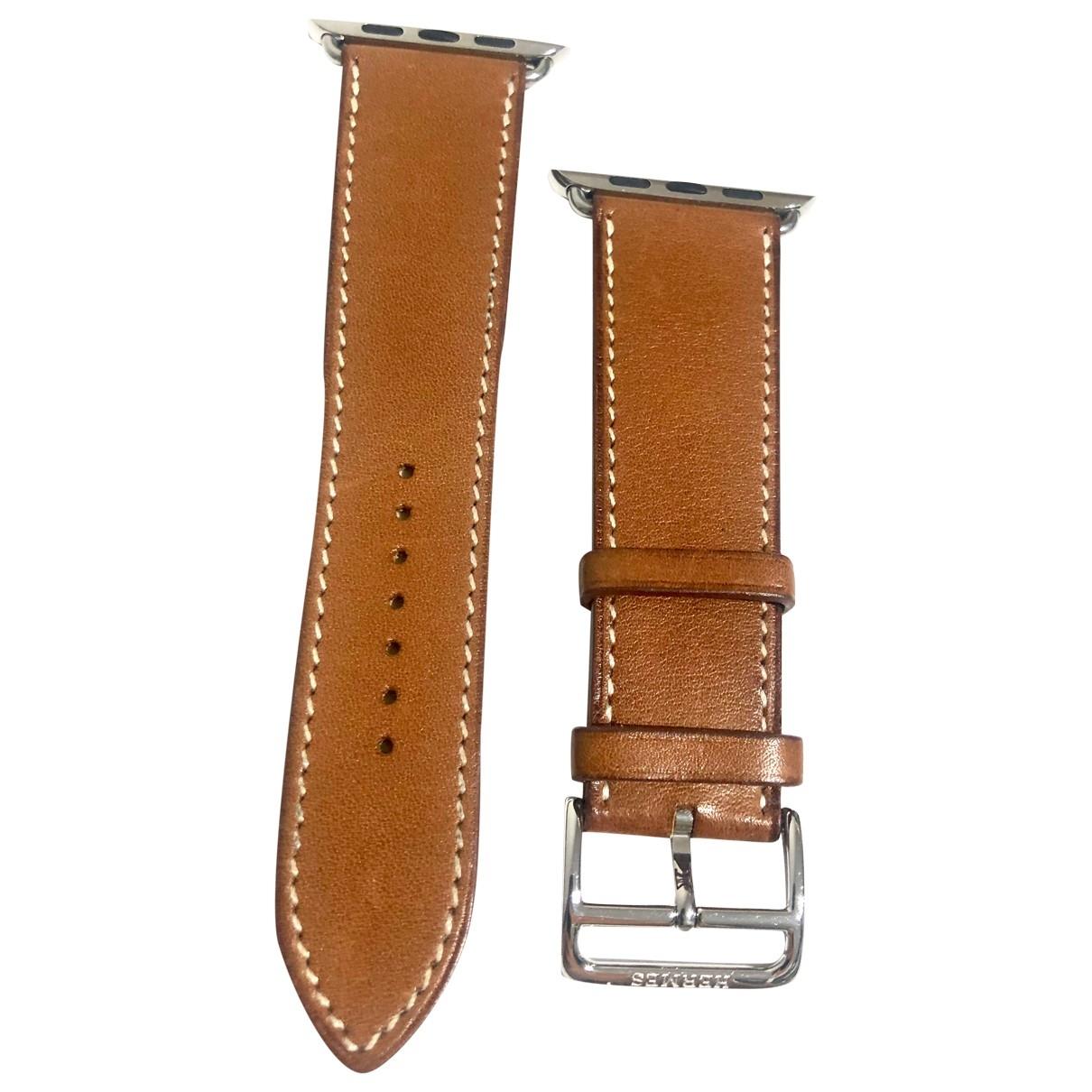 Hermes - Montre   pour femme en cuir - marron