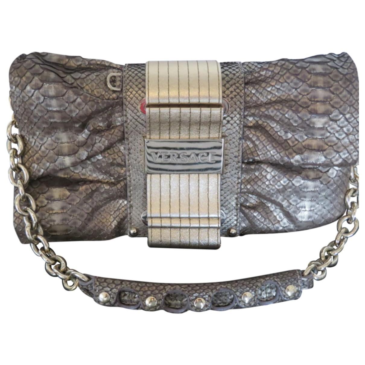 Versace \N Handtasche in  Gold Python