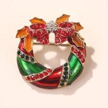 Broche con diseño de lazo de Navidad