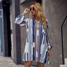 Vestido tunico de cuello V con estampado geometrico