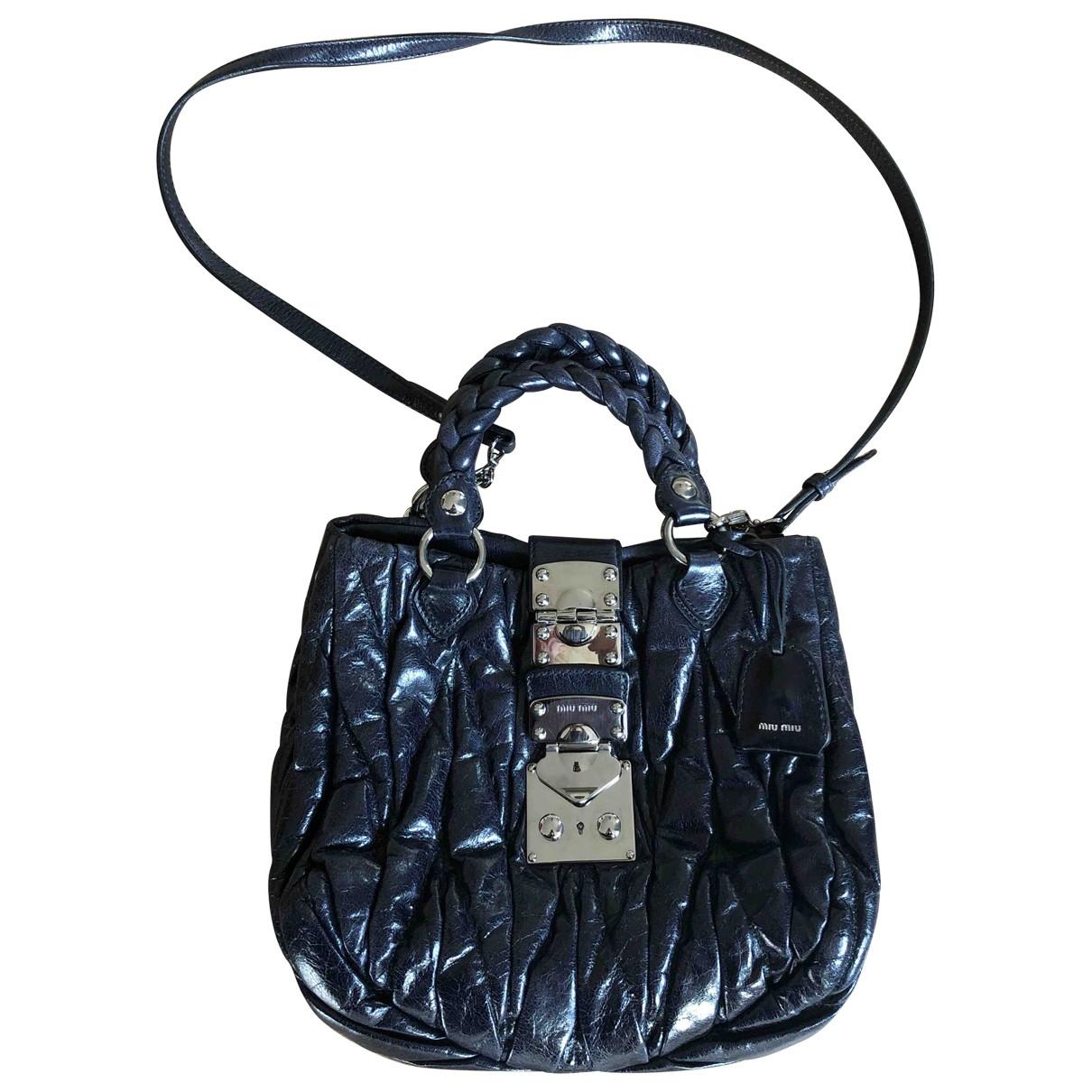 Miu Miu Matelasse Handtasche in  Blau Leder