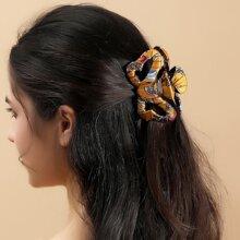 Haarklaue mit Lochern