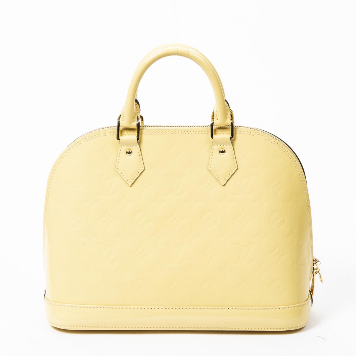 Louis Vuitton - Sac a main Alma pour femme en cuir verni - jaune