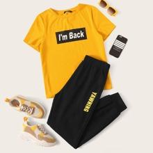Conjunto top con slogan y dibujo con pantalones deportivos