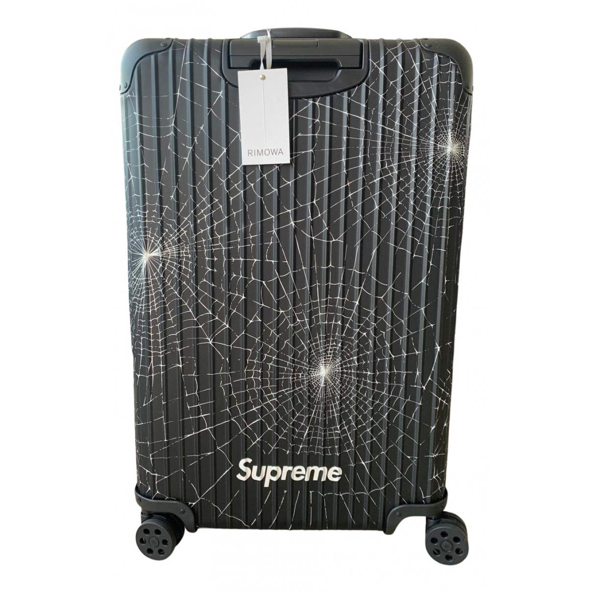 Viajes Rimowa X Supreme