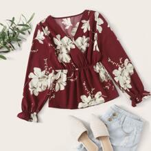 Camisa floral peplum cruzada delantera
