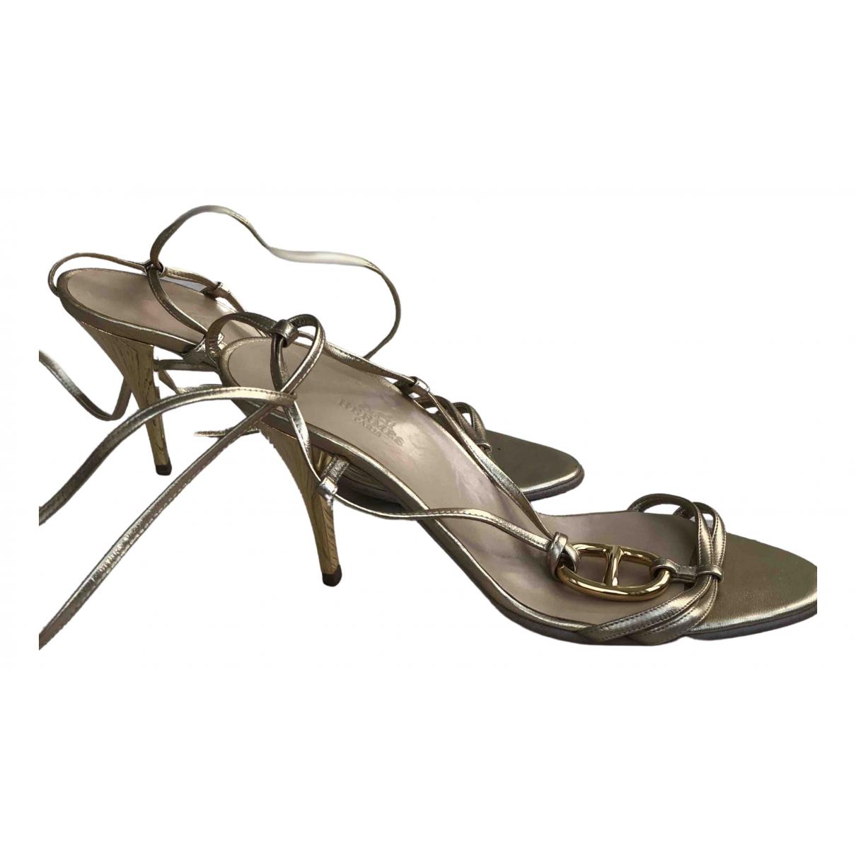 Hermes - Sandales   pour femme en cuir - dore