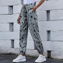 Pantalones con bolsillo con estampado de galaxia
