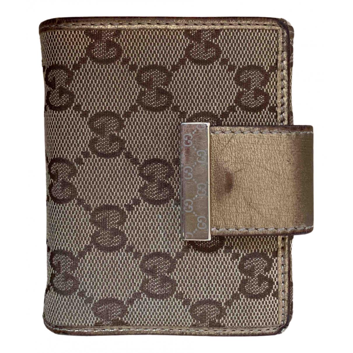 Gucci - Portefeuille   pour femme en toile - dore