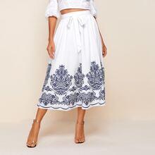 Falda con cinturon con estampado tribal