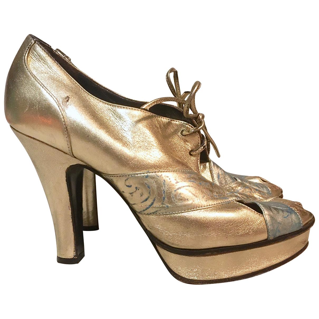 Fendi - Boots   pour femme en cuir - dore