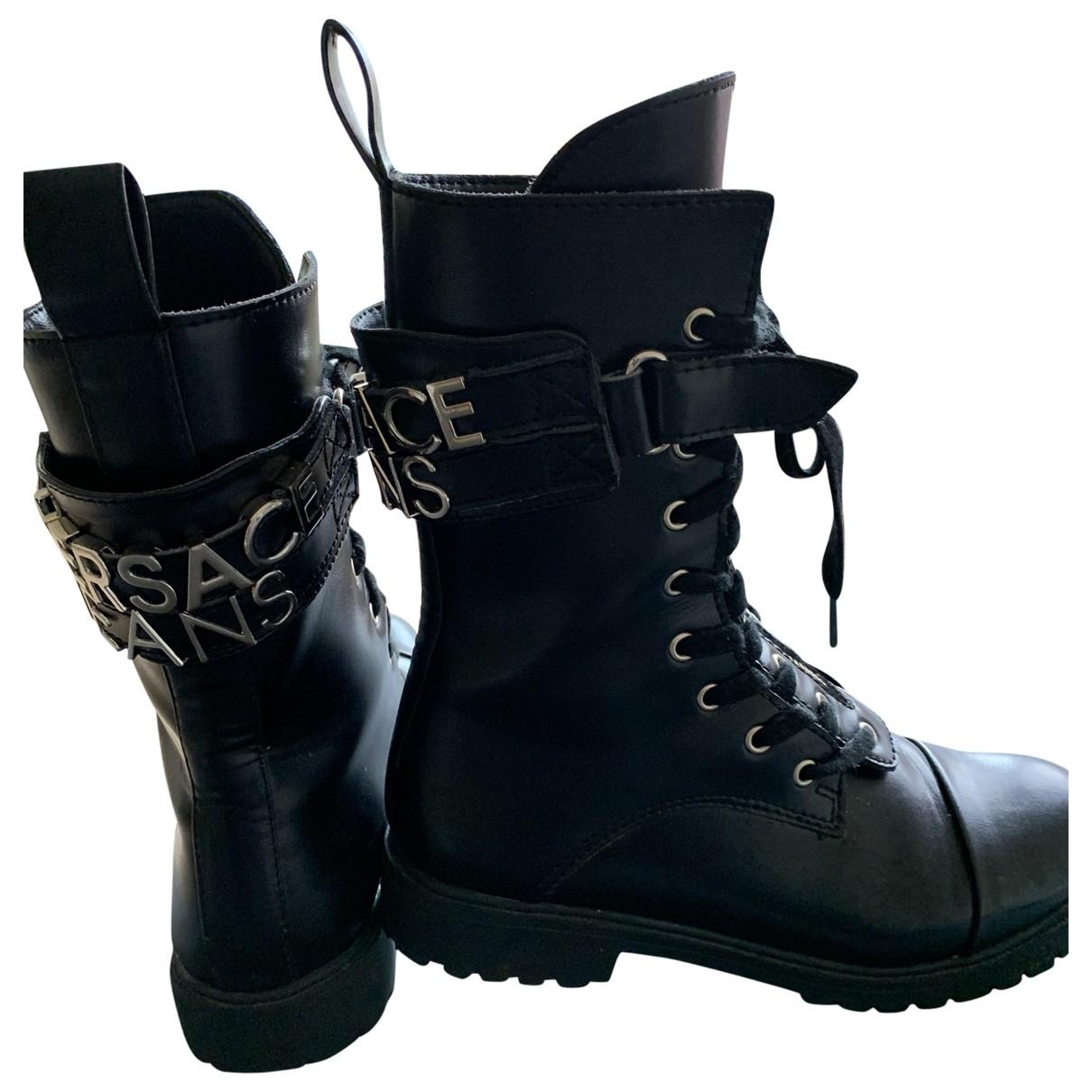 Versace Jean - Boots   pour femme en fourrure - noir