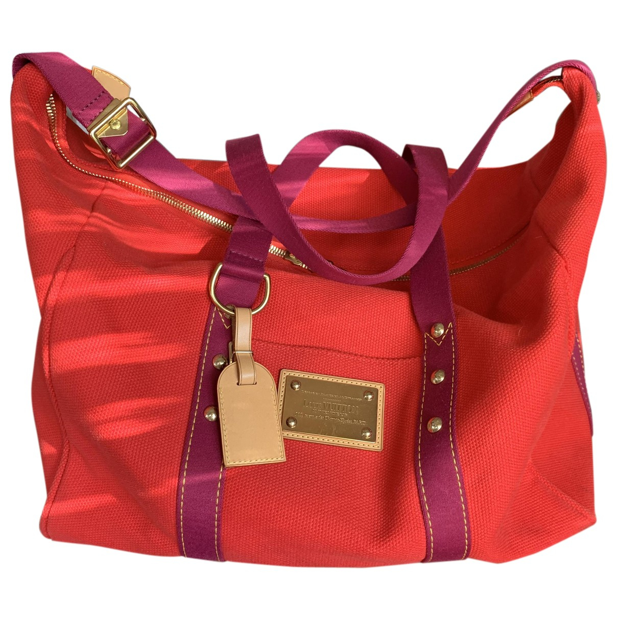 Louis Vuitton - Sac de voyage   pour femme en toile - rouge
