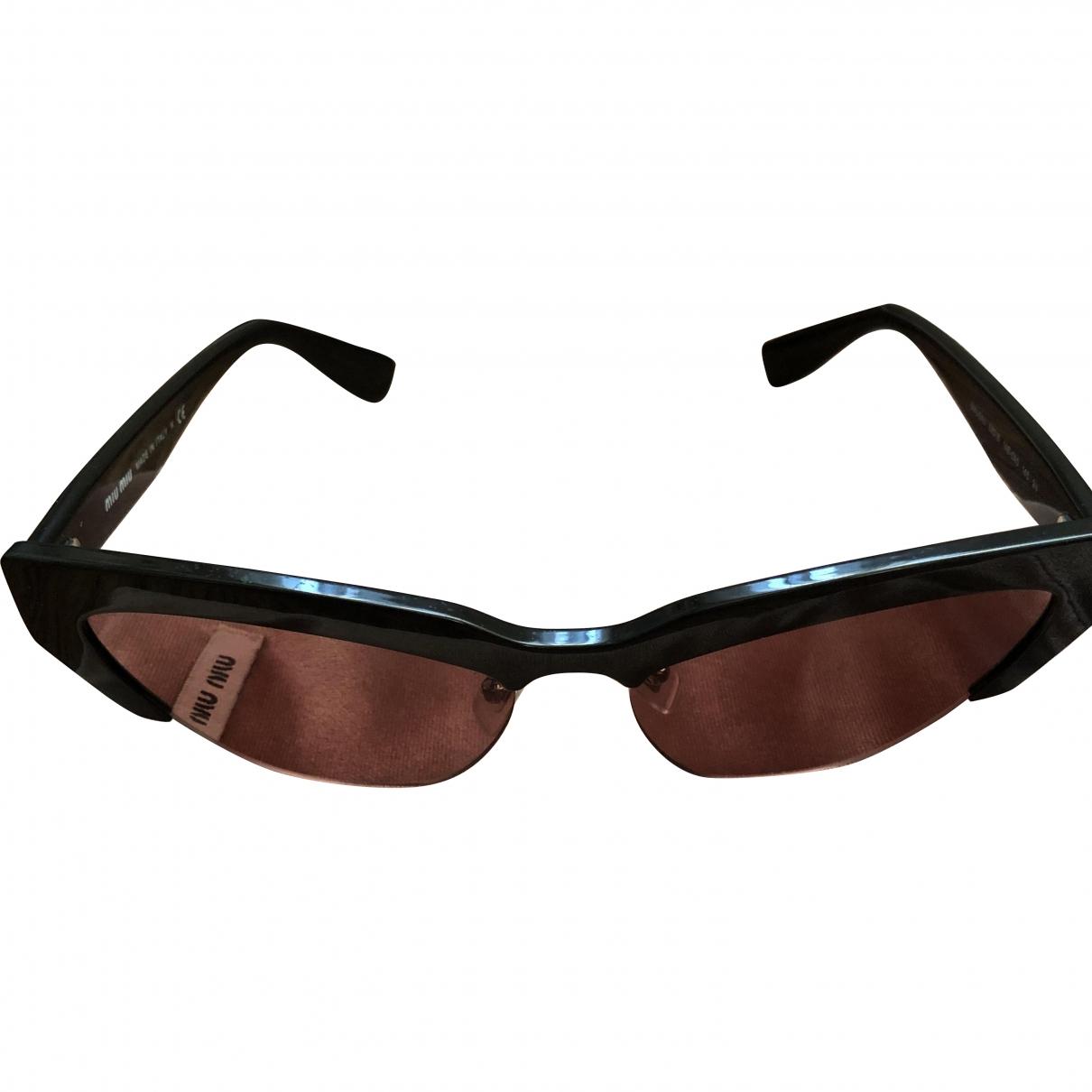 Miu Miu \N Sonnenbrillen in  Schwarz Kunststoff