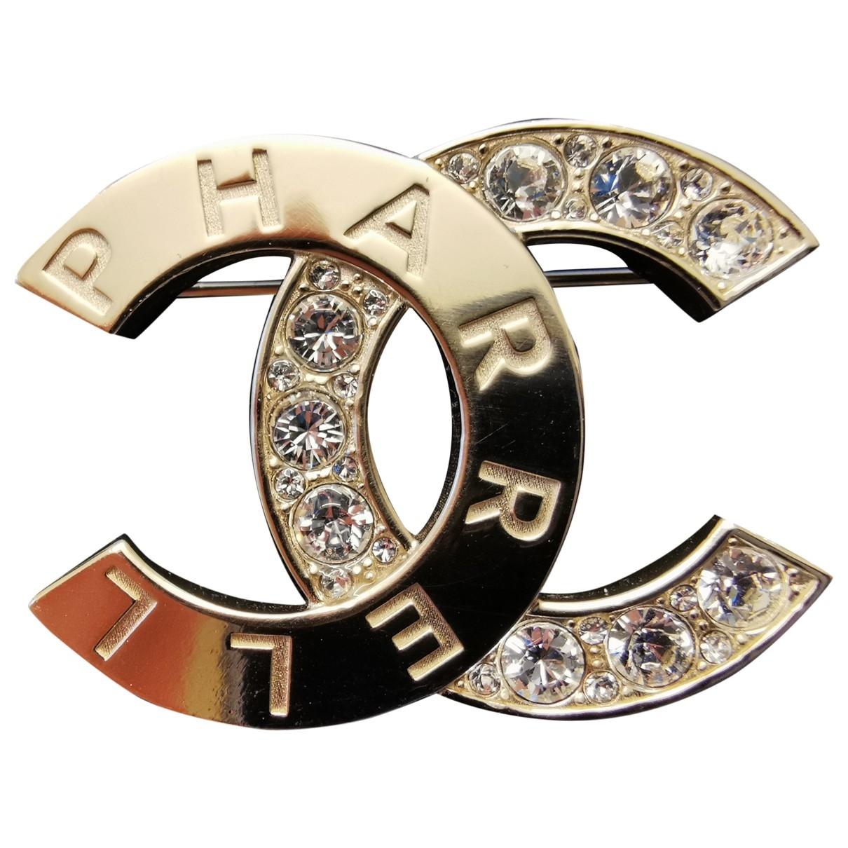 Chanel X Pharrell Williams - Broche   pour femme en metal - dore