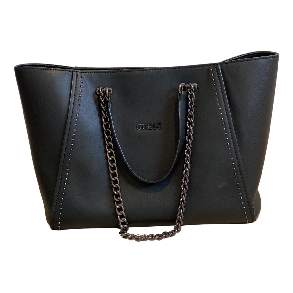 Guess \N Handtasche in  Schwarz Synthetik