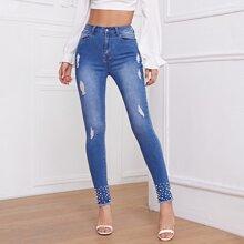 Skinny Jeans mit hoher Taille und Perlen