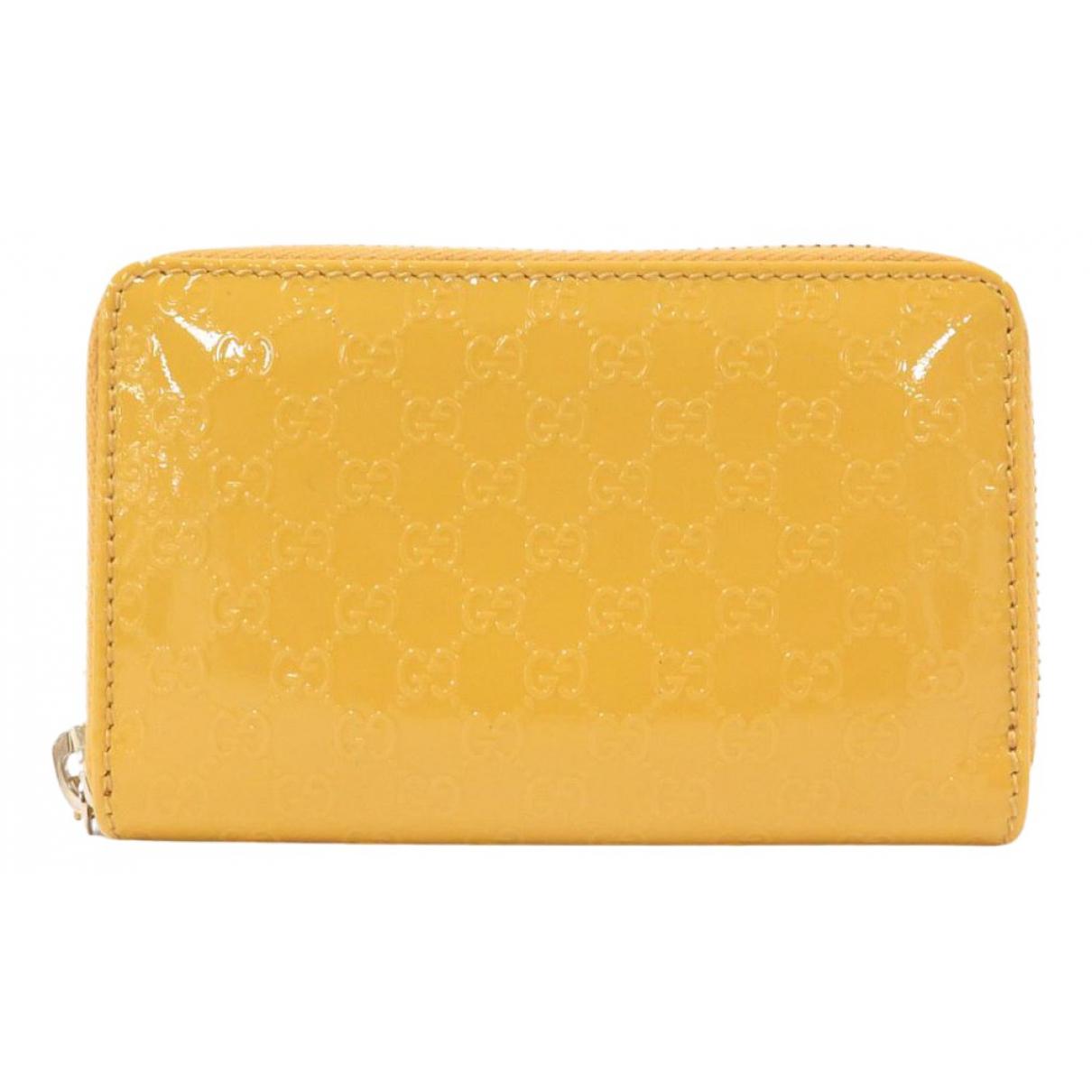 Gucci - Portefeuille   pour femme en cuir verni - jaune
