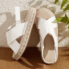Sandalias de talon abierto con tiras cruzadas minimalista