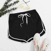 Shorts de cintura con cordon bajo delfin