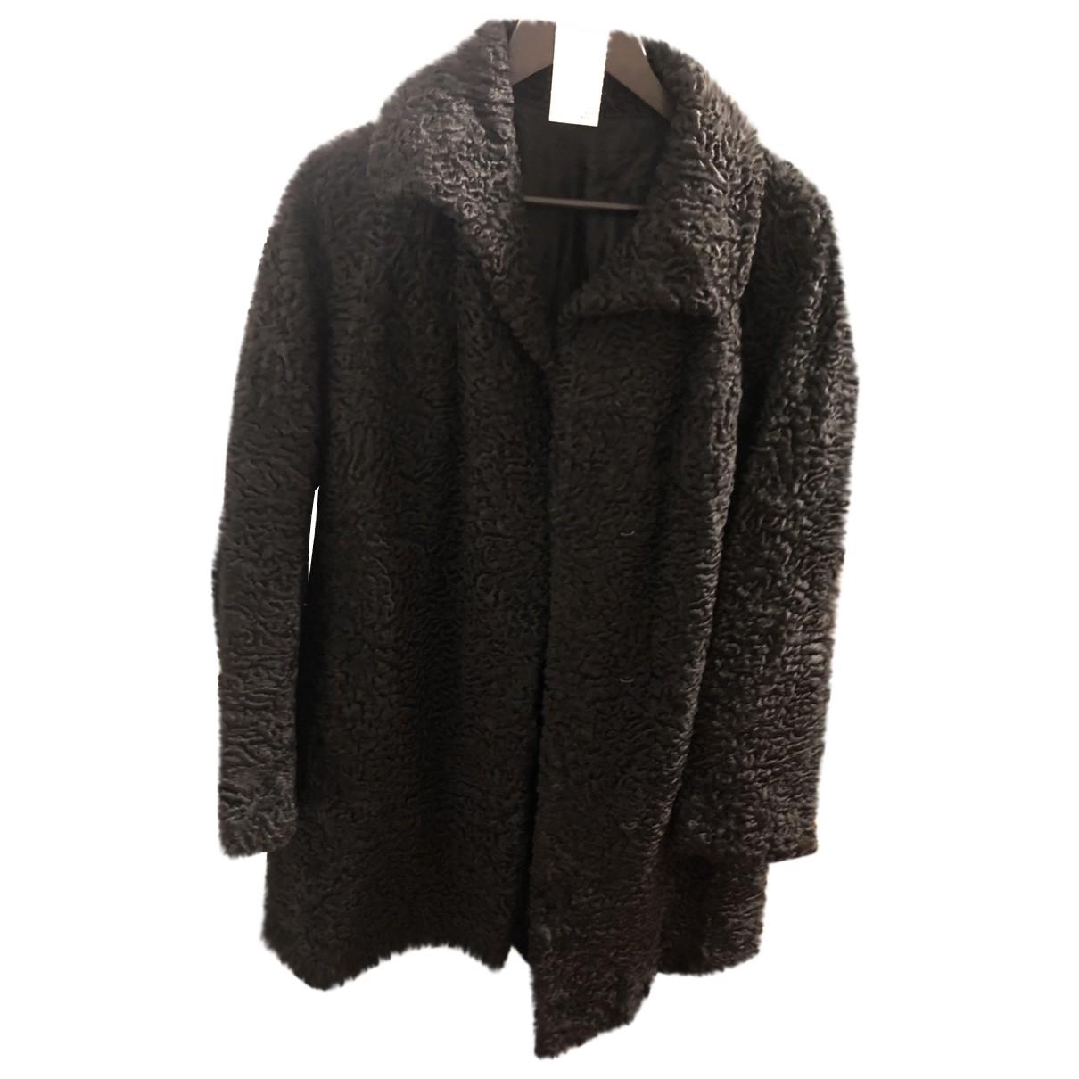 - Manteau   pour femme en fourrure - noir