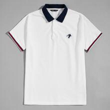 Polo Shirt mit Grafik Stickereien