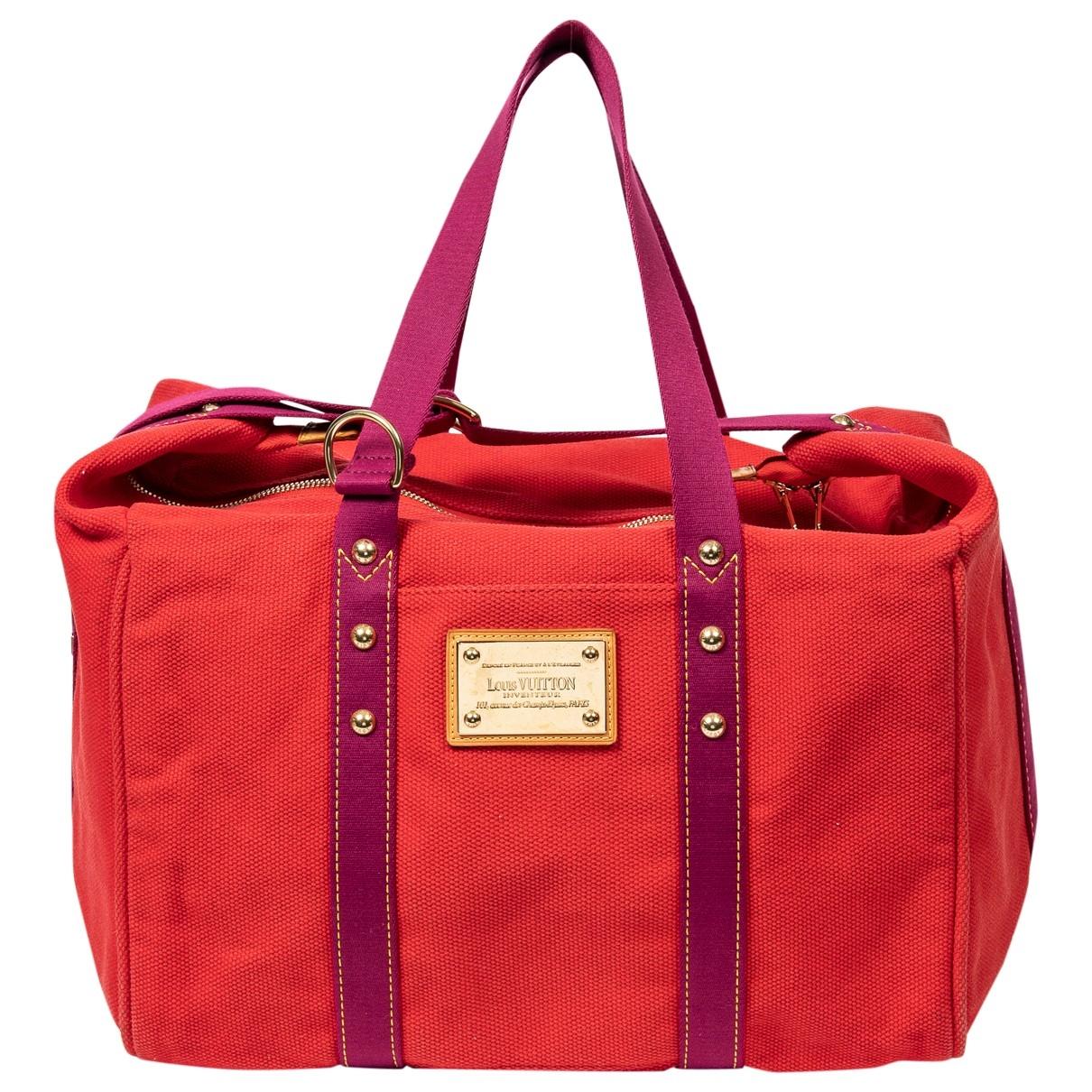 Louis Vuitton Antigua Handtasche in  Rot Leinen