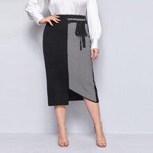 Falda tejida bajo asimetrico panel de rayas con cordon delantero