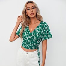 Camisa corta cruzada con estampado floral