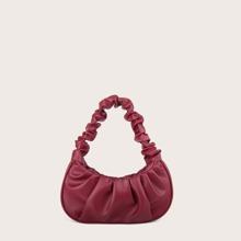 Minimalistische Tasche mit Ruesche