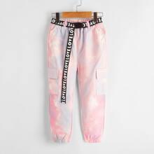 Pantalones con bolsillo con solapa con estampado de tie dye con cinturon