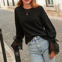 Pullover mit Spitze und Schosschenaermeln