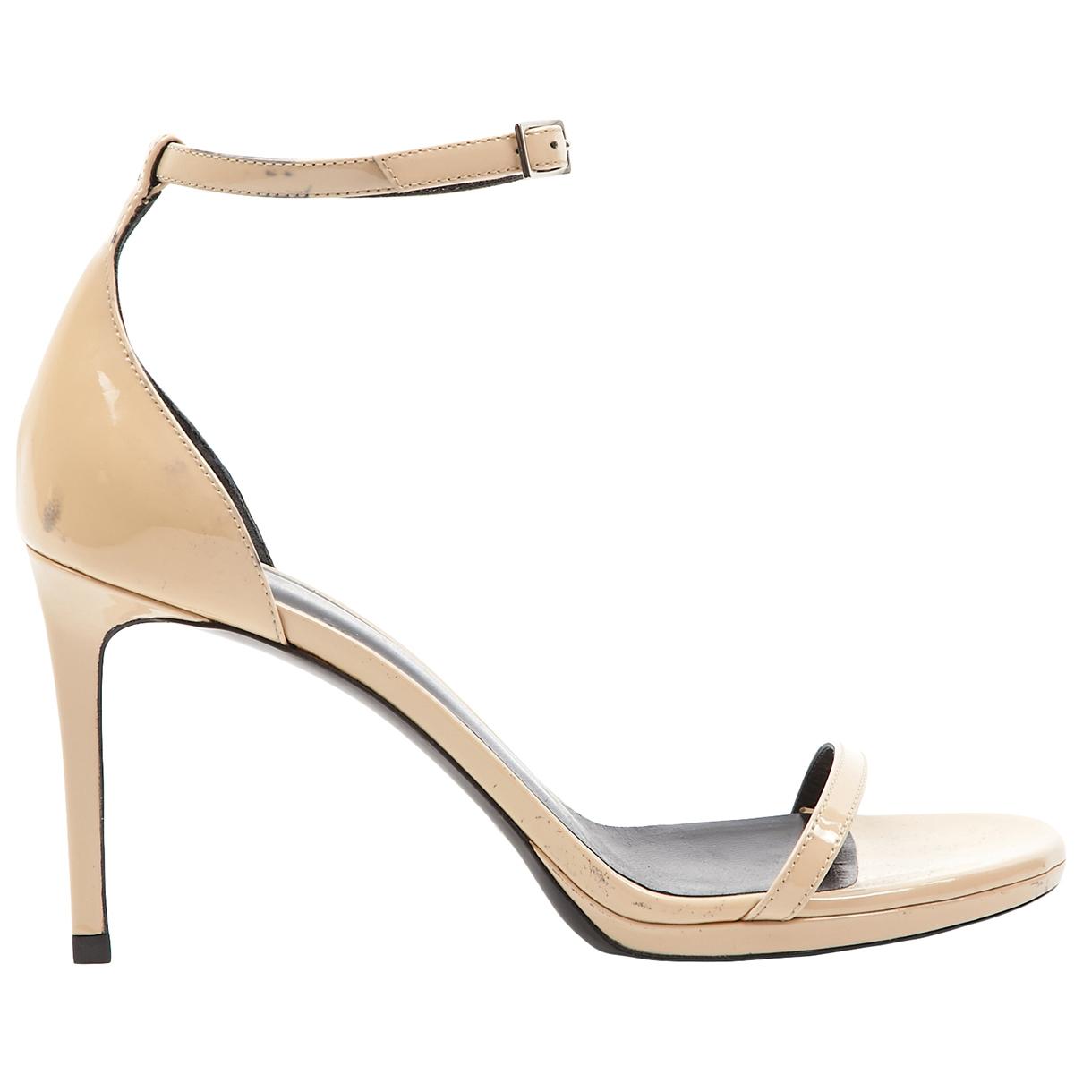 Saint Laurent \N Beige Patent leather Sandals for Women 38 EU