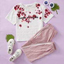 Conjunto top floral con letra con pantalones de lado de rayas