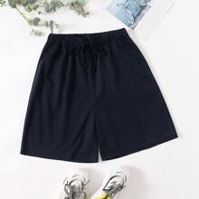 Shorts unicolor de cintura con cordon