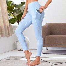 Einfarbige Leggings mit breitem Taillenband und Handytasche