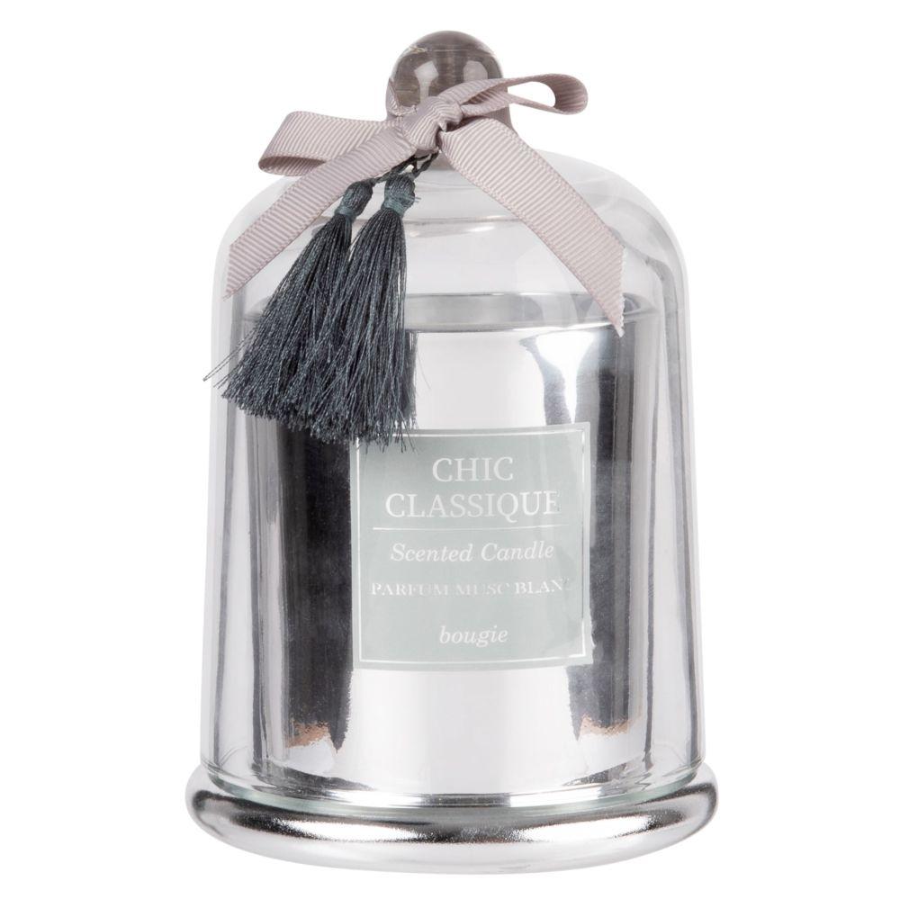 Silberfarbene Duftkerze unter Glasglocke