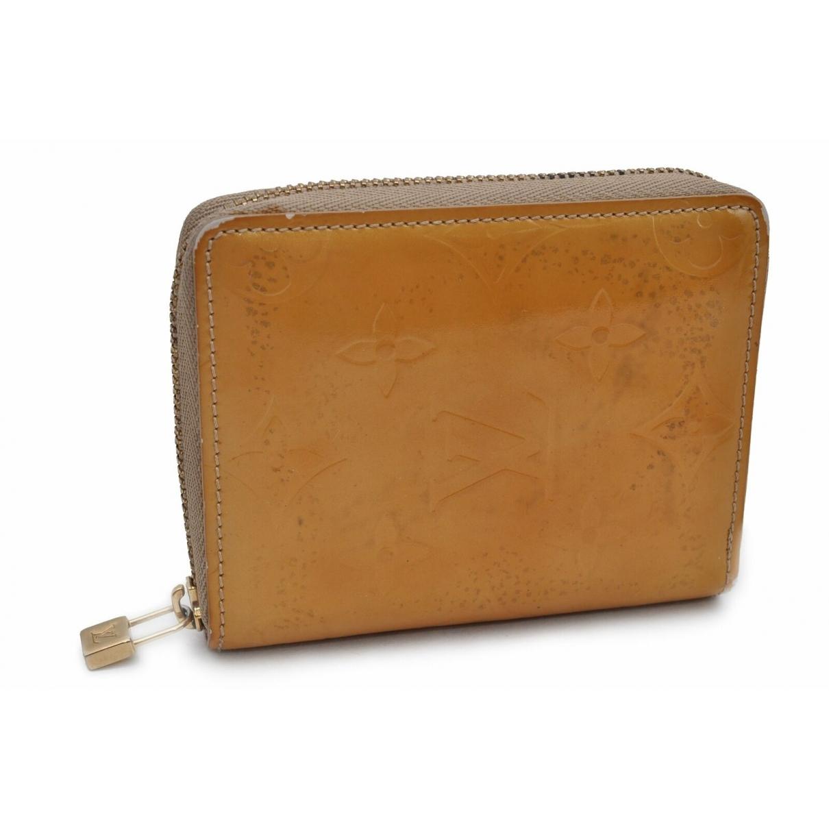Louis Vuitton - Portefeuille   pour femme en cuir verni - jaune