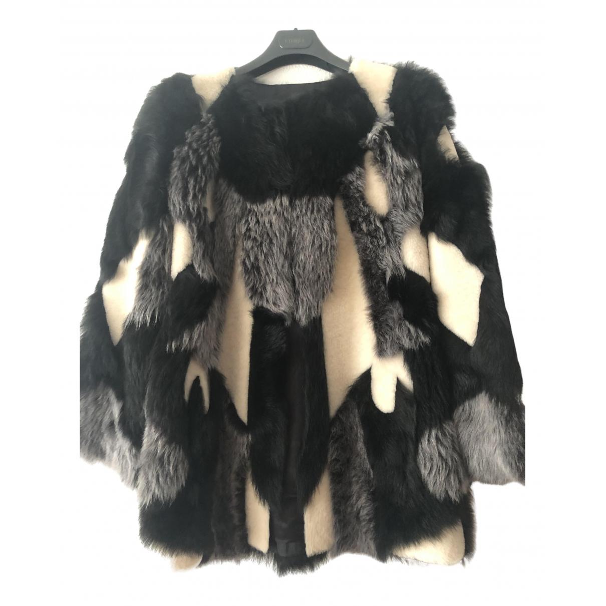 Uterque - Manteau   pour femme en fourrure - noir