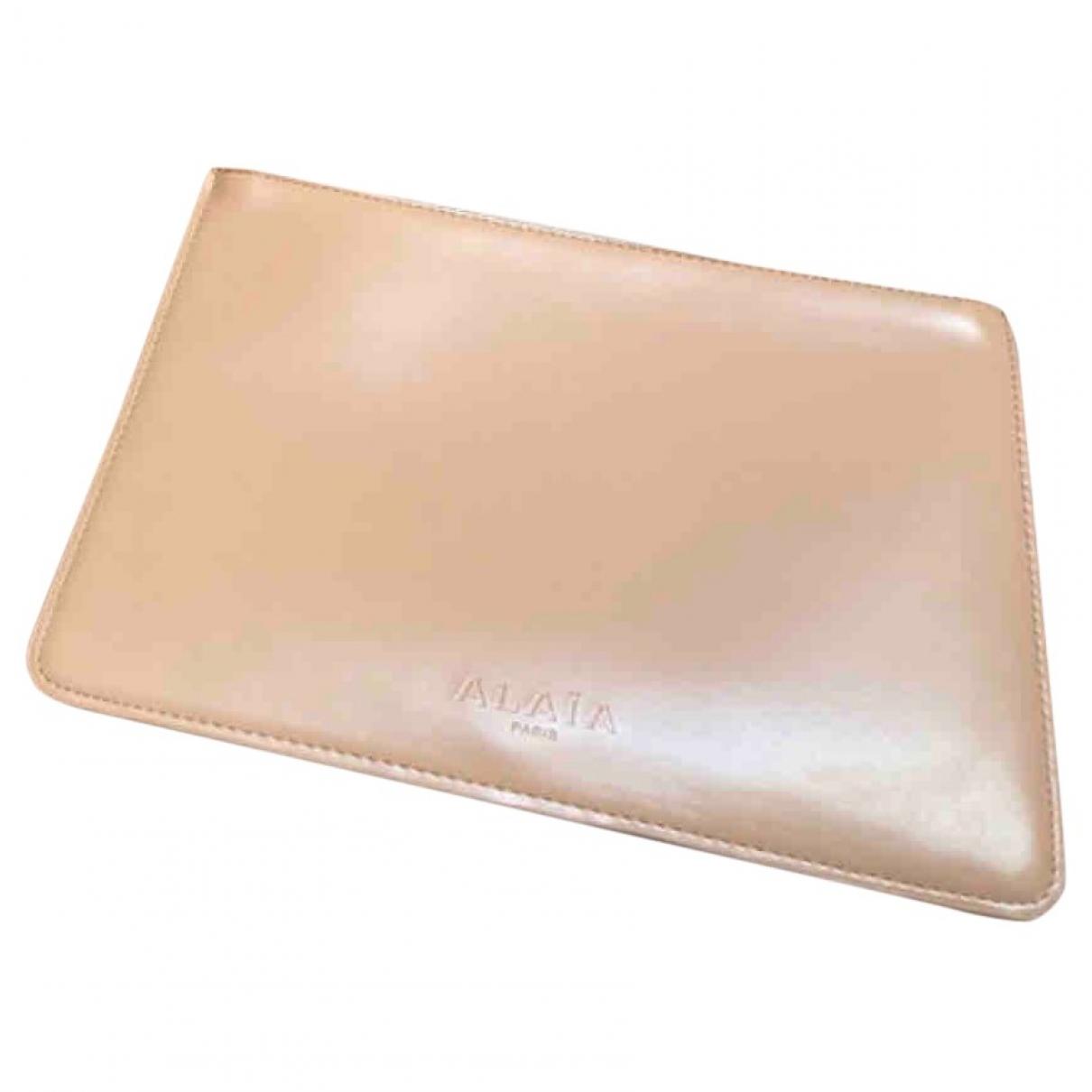Alaia - Pochette   pour femme en cuir - beige